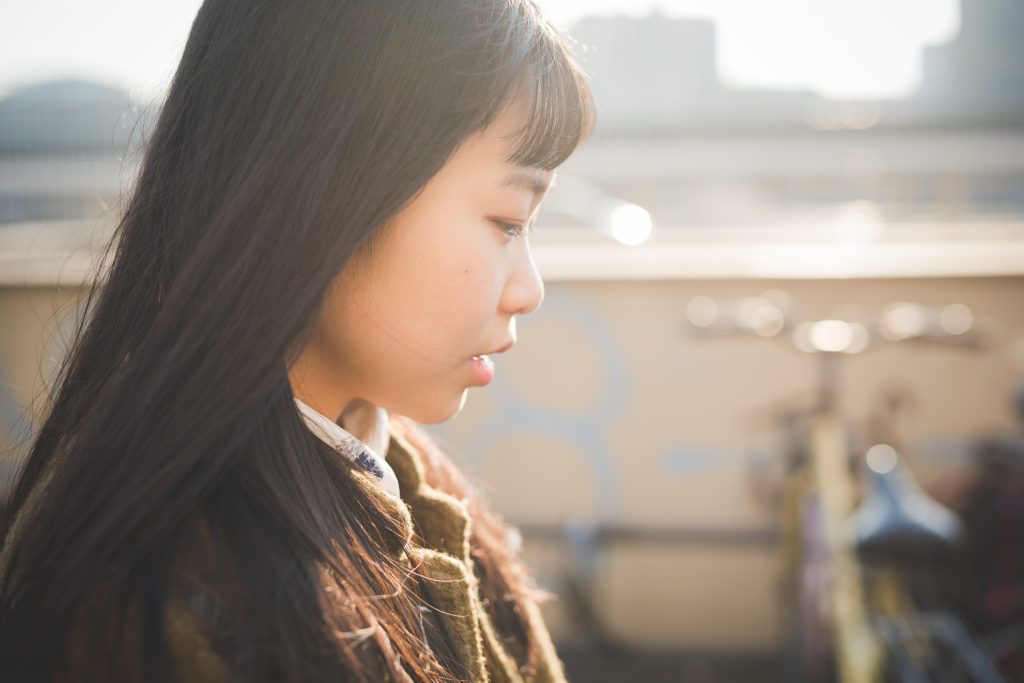 young beautiful asian girl nose